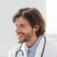Physician looks happy in his clinic